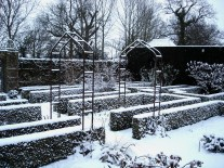 Snow highlights the straight lines in The White Garden