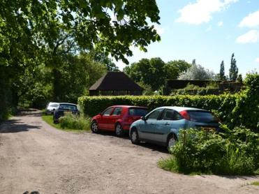 Cars parked outside the garden.