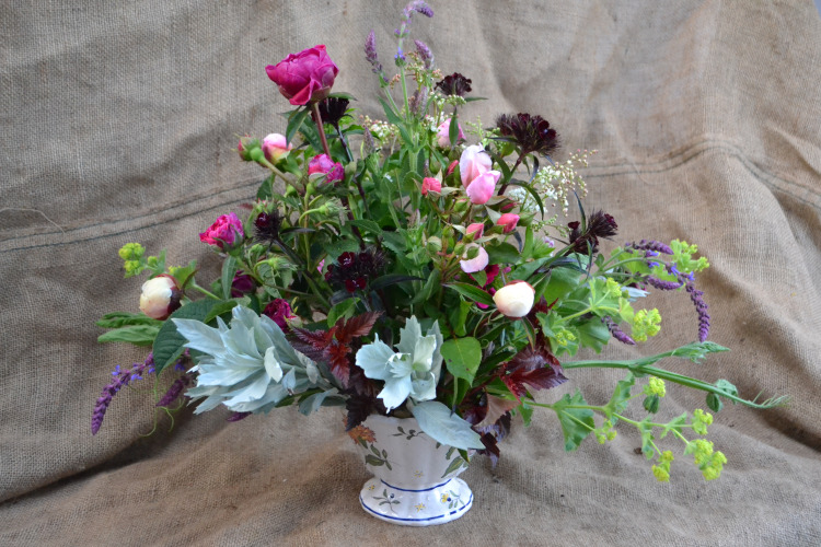 An arrangement with roses & perennials