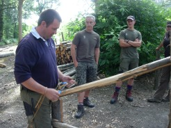 "David demonstrates peeling the timber. (Photograph used with kind permission of David Dunk of ""David Dunk – Hedge laying and Fencing"")"