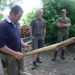 """David demonstrates peeling the timber. (Photograph used with kind permission of David Dunk of """"David Dunk – Hedge laying and Fencing"""")"""